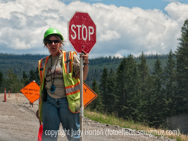 11/8/12 - Highway worker; I grabbed this shot of a highway construction worker when we had to wait to be led through a construction zone on the way to Grand Teton National Park.  <br /> <br /> Thanks for your warm response to my shot of the antique drilling equipment.  So many wonderful shots on smugmug today and so much creativity in evidence!<br /> <br /> Constructive criticism is always welcome.  I shot this through the window of the car and did not have much leeway in terms of the composition.