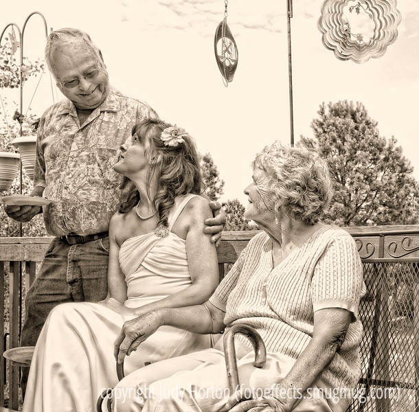 The Bride and Her Grandparents - This is one of my favorite shots from the wedding I photographed recently.  The wedding was held at the home of the grandparents of the bride and they shared a tender moment after the ceremony, which was captured in this shot.  Hope everyone has a grand day!