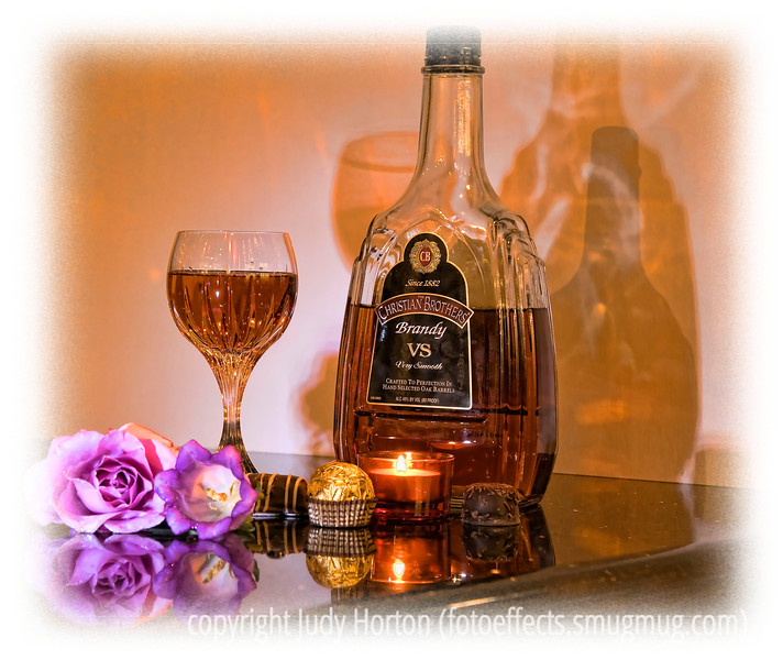 Day 115 - Still life with brandy and roses; I've been shooting some still lifes over the last few days and this is one of them.  The detail in the photo shows up much better in a larger size.  It is supposed to be really warm today so my hubby and I may drive down the the Great Sand Dunes to take some photos.  Thanks for all the comments on my Ice and Bubbles image.  I'm looking forward to seeing all of your great images.  Have a great day today!