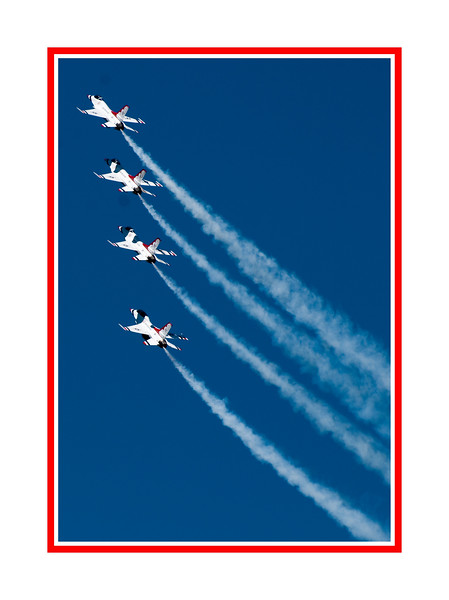 "Four members of the USAF Thunderbirds climb into the sky during the 2009 performance at the USAF Academy graduation; view the details in the largest sizes.  This is one of the sharpest shots I got of the Thunderbirds and one of the reasons I chose it for my daily was that there were shadows cast by the plane ahead on each of the planes except for the leader. I thought that was interesting.  Some of the other shots i took included ones of the planes flying near Pike's Peak.   I took several hundred shots but have posted about 49 in a Thunderbirds Gallery (under Airplanes).  If you are interested in seeing the other shots, click here:  <a href=""http://fotoeffects.smugmug.com/gallery/8365387_LvF9u#P-1-12"">http://fotoeffects.smugmug.com/gallery/8365387_LvF9u#P-1-12</a>.<br /> <br /> Watching this graduation day performance is becoming a regular event for many residents of Colorado Springs.  Actually attending the graduation is not the best place to watch the Thunderbirds.  The Academy is located on one side of I-25 and a number of businesses are located on the other side.  People drive to a spot on the east side of the freeway and park there to watch the performance.  We've been doing this ever since we moved to the area...about five years.  Since a new Hollywood Theater has gone in just across from the stadium, we've been going there.  Last year there were quite a few people at the spot, but this year the entire parking lot, overflow lot and all the little feeder streets were completely filled with watchers.  It has become quite a party.  Some people set up little awning things under which they have a picnic.  Some people grilled food.  Most bring chairs and snacks.  Some of us go into the theater and buy popcorn and other food.  Most folks arrive several hours before the Thunderbirds arrive.  The Thunderbirds always arrive several days before the graduation to practice.  They practice a couple of times a day and many of us have them flying directly over our homes during the routine, so, even if we had not been keeping up with the date of the graduation, by the time the day arrives, virtually everyone is aware of it because of having seen the team practicing.  It is a lot of fun.  There were lots of folks taking photos, although at the Hollywood Theater location, I certainly had the biggest lens, which is a decided advantage.<br /> <br /> Hope you like the shot and have a really nice Friday!"