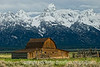 John Moulton's Barn must be one of the most photographed spots in the Grand Tetons.  Nonetheless, I was anxious to try to capture it.  The morning was quite cold and dreary.  The mountains were pretty well shrouded in clouds.  As I set up my camera and tripod, I thought I had almost no chance of getting a good shot and then, suddenly, the clouds lifted, the sun peeked through and I got a few decent shots.  Hope you like this one.<br /> <br /> I was very busy today and did not get to comment on too many of your shots.  I'll try to catch up with everyone tomorrow.  Enjoy your day!