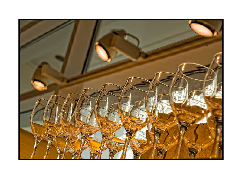 Crystal goblets at the Crate and Barrel; best viewed in the largest sizes. I liked the golden reflections in the glasses that almost look as if they have wine in them.<br /> <br /> We are off this morning for three weeks --- to the Grand Canyon, Canyon de Chelly, Sedona, Phoenix, Globe, and other assorted spots in Arizona and New Mexico.  We're hoping to get an early dose of spring and I hope to get lots of photo ops.  We won't have any internet access until after March 19, so I won't be able to post or comment.  Hopefully, I'll be able to get on after that for a bit.  Hope all of you are well and happy while we're gone!