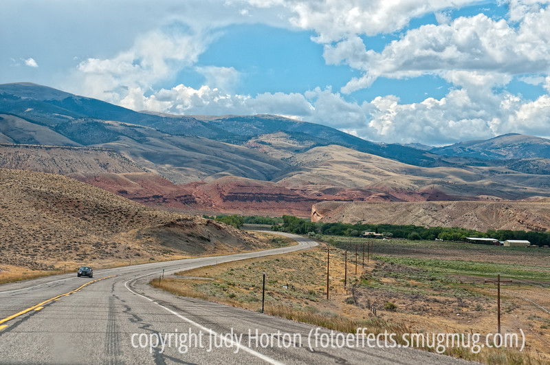 9/6/12 - Near Dubois, WY; a lot of the landscape between Dubois and Lander looks very similar to this.  Best viewed in the largest sizes.  Although it is not as dramatic as the shots I've seen of the Palouse, this reminds me a bit of that kind of landscape in the way the light and shadow highlights the contours of the hills.  It is very pretty country, with lots of prosperous looking farms.  I was surprised that there is a lot of crop irrigating being done in the area.  I actually shot this from our moving car.  I've discovered if I shoot at a shutter speed of 1/1000 second from the moving car, I generally get fairly sharp shots.<br /> <br /> Thanks for the comments and support on my portrait of the nature lover.  Much appreciated.  There were so many wonderful shots on smugmug and I really enjoyed looking at them.  I learn so much just by looking at your shots!<br /> <br /> Constructive criticism is always welcome!