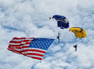 Parachutists Before the Game - at the Air Force/Army game Saturday, a pre-game performance by parachutists from the Air Force Academy and West Point.  The man with the flag is a retired Air Force parachutist and a double amputee, who lost both legs in a mid-air collision with his partner, who died in the accident.  The other parachutist in this shot is a West Point cadet.  Please view this image in the largest sizes to see the detail of the parachutists, including the prothestics of the man with the flag.  I was amazed at the response to my shot of part of our yard during a recent snowstorm.  You all have made me consider using it as our Christmas card this year.  Hope everyone has a good day today!