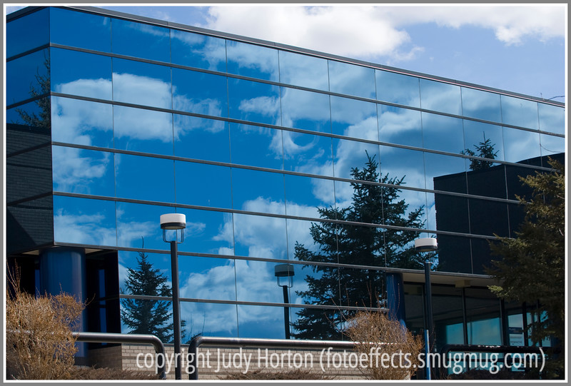 Day 82 - Reflections of clouds in an office building
