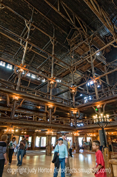 For DakotaCowboy, the Lobby of Old Faithful Inn, Yellowstone.  It soars to about 80 feet above two balconies and has a crow's nest at the top.  the crow's nest can no longer be visited, as some of the supporting beams were damaged in an earthquakel.  The light was very poor in this interior and it was so big a space that the flash had little effect.  I shot this at 1/80th second, with the exposure compensation bumped way up.  It was handheld.  You can really see the detail of the construction in the larger sizes.<br /> <br /> We're off to the Cherry Creek Arts Festival today.  Hope everyone has a great 4th of July weekend!