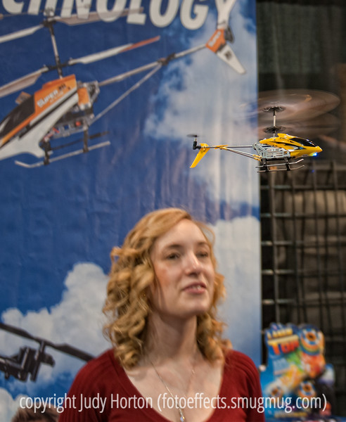 An RC helicopter buzzes around the head of a young woman; best viewed in the largest sizes.  I was happy to capture the rapidly moving RC helicopter reasonably well.<br /> <br /> Thanks for your comments on my shot of the motorcycle.  Much appreciated!  Hope everyone is having a good week!