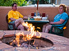 Enjoying a summer evening - We ate at a Mexican restaurant in Monument, CO, the other night and I grabbed this shot of a couple enjoying the evening next to an outdoor fire pit.  Hope everyone has a good day.  The orange on the far right is a piece of flame.  I thought about removing it...what do you think I should do about it?