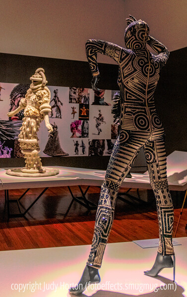 "World of Wearable Art Exhibit at the Colorado Springs Fine Arts Center - some of you have asked if the garments are actually worn.  They are worn only during the performances of the actual festival, which occurs during a 3-week period.  Entrants are encouraged to be as creative as possible in designing fantasy garments.  In no way are they intended to be practical garments.  Anyone may enter the contest.  They create their garment and photograph it with up to 10 photos, which MUST include photos showing how people get in and out of the garments.  They must be designed to fit certain sizes.  If you search on ""World of Wearable Art"" on google, you will get a plethora of links to the contest site, as well as videos of previous competition winners.  Thisi particular entry was inspired by the tattoos with which indigenous peoples of the South Pacific have been decorating themselves for thousands of years."