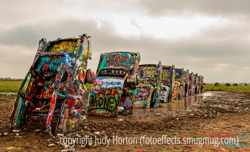 Cadillac Ranch, Amarillo, TX - those are spray cans littering the ground; they say that if you spray something on the cars, it will be covered over by someone else's paint within a couple of hours.