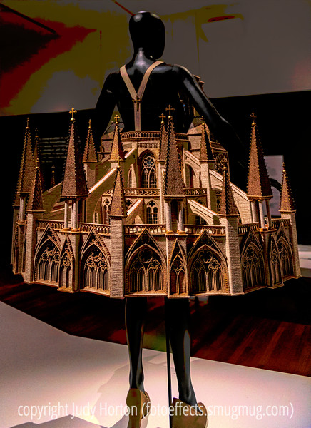 """World of Wearable Art Exhibit at the Colorado Springs Fine Arts Center - This elaborate construction is made of wood, covered with felt.  some of you have asked if the garments are actually worn.  They are worn only during the performances of the actual festival, which occurs during a 3-week period.  Entrants are encouraged to be as creative as possible in designing fantasy garments.  In no way are they intended to be practical garments.  Anyone may enter the contest.  They create their garment and photograph it with up to 10 photos, which MUST include photos showing how people get in and out of the garments.  They must be designed to fit certain sizes.  If you search on """"World of Wearable Art"""" on google, you will get a plethora of links to the contest site, as well as videos of previous competition winners."""