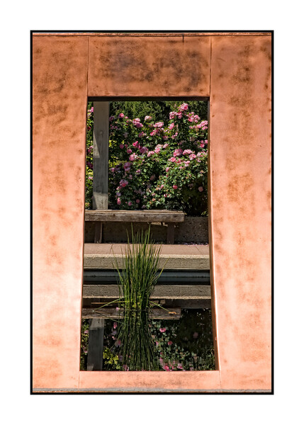 View through a copper sculpture in a pool at the Denver Botanic Gardens