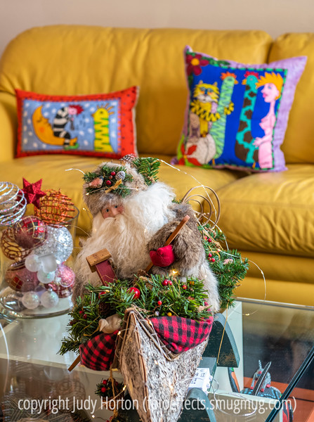 Merry Christmas!  Have a wonderful day! - One of the Santas in my collection;  I painted the pillows in the background in the style of some pillows that I bought many years ago..