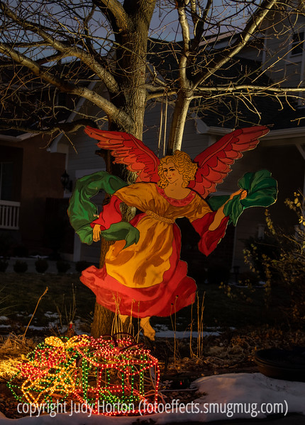 Outdoor Christmas Decorations - I painted the angel and my husband cut her out for me about 30 years ago.  She has been outside during the holidays in all types of weather all but four years since that time.