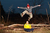 "Jumping Nini, Columbia MO<br /> <br /> There was no sunset at Grindstone Nature Area yesterday, so we decided to have a little fun with a pair of speedlites.  The goal was to get a shot of Big Red leaping over the logs, but he wasn't very interested.  So I ended up jumping over the logs myself about 50 times!  I trained myself well!  In the end I didn't get the shot I envisioned, but we had a blast anyway.  For a view of all four of us at once see my other daily here:  <a href=""http://smu.gs/vjSRnW"">http://smu.gs/vjSRnW</a><br /> <br /> The two speedlites were placed at 45 degree angles from where Nini is sitting, shot through small umbrellas.  I was surprised to find that the flashes do a great job of freezing the action with light, so you don't need a super fast shutter speed.  This photo was shot at 1/125 of a second.  I used four cheap remote tranceivers to fire the camera and flashes from mid-air!  The tranceivers are available here (although you should find the right model for your camera):  <a href=""http://amzn.com/B004YTA15W"">http://amzn.com/B004YTA15W</a><br /> <br /> Daily photo: Dec 3, 2011, taken Dec 2, 2011"