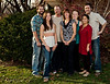 Thanksgiving Portrait, Omaha NE<br /> <br /> We took this portrait over the Thanksgiving holiday and I've just processed it for a holiday project I'm working on.  From left to right we have Nick, Kristy, Bruce, Kim, Taylor, Nini, and ME.  Everyone was worried that their feet would be in the shot and none of us took the time to put on proper shoes.  Everyone except Nini that is.  Check out her Indian Juttis.  If you've never seen Juttis before, they have a distinctive curved toe, similar to the shoes elves are depicted to wear.  So anyway, I guess I better use a 3/4 crop on the bodies to get rid of the shoes....   WHAT DO YOU THINK?<br /> <br /> Update: Well I didn't think Mom would see this...  the cat's out of the bag now!<br /> <br /> Daily photo: Dec 13, 2011, taken Nov 24, 2011
