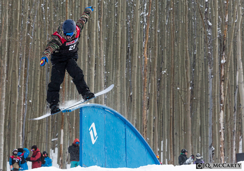 Jake Orzech, of Snowmass Village, board slides a rainbow rail during the USASA Vail Slopestyle competition Saturday, January 10th, in Golden Peak.