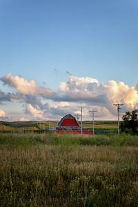 Abandoned Red Barn in a Grassy Field in Rural Nebraska