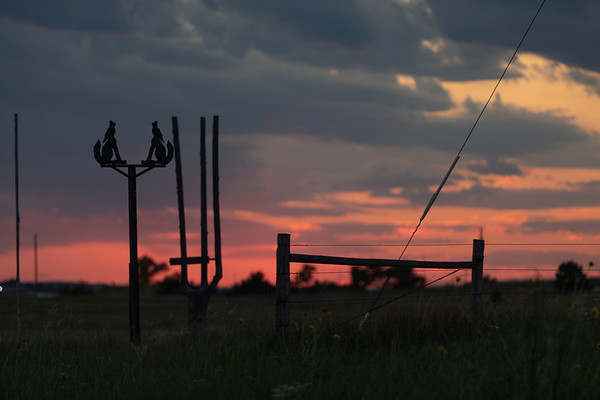 Midwest sunset with Metal Figures in the foreground and a beautiful sunset in the background