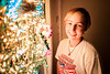 """Taylor and the Lights, Nacogdoches TX<br /> <br /> I was in my office grading final exams yesterday when I got a knock on the door.  I shouted """"come in"""" and to my great surprise my little sister Taylor popped open the door and shouted """"surprise!""""  My mom and stepdad were there too!  It was an awesome birthday present for my 30th!  I'm so lucky to have such an amazing family!  Taylor and Bruce helped me put up some Christmas lights in our bedroom window.  We don't really decorate for the holidays but we do have a big pile of lights and usually put them all in one window.  After we were done Taylor posed for a few quick shots.<br /> <br /> Thanks Mom, Bruce and Taylor for making my 30th birthday awesome!  <br /> <br /> Daily photo: December 11, 2012, taken December 10, 2012"""