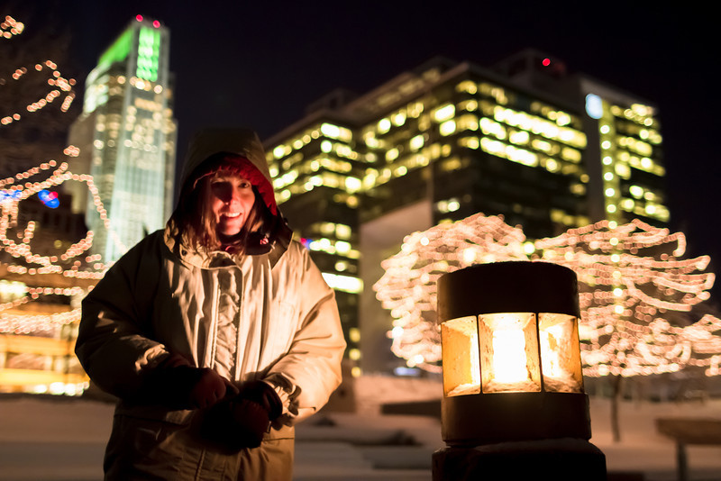 Happy New Year!, Omaha NE<br /> <br /> My favorite shot from downtown Omaha, my mom posing by the lights along the Gene Leahy Mall.  Thanks for driving me mom!<br /> <br /> Happy New Year everyone on smugmug!  I really appreciate all or your support and helpful advice.  My New Year's resolution is to travel outside of the US in 2013.  Of course I want to accomplish a lot more than that…<br /> <br /> We're off to Colorado for Nini's first ski trip ever, and my first ski trip in about 15+ years.  Wish us luck!<br /> <br /> Critiques are always welcome.  <br /> <br /> Daily photo: December 31, 2012, taken December 20, 2012