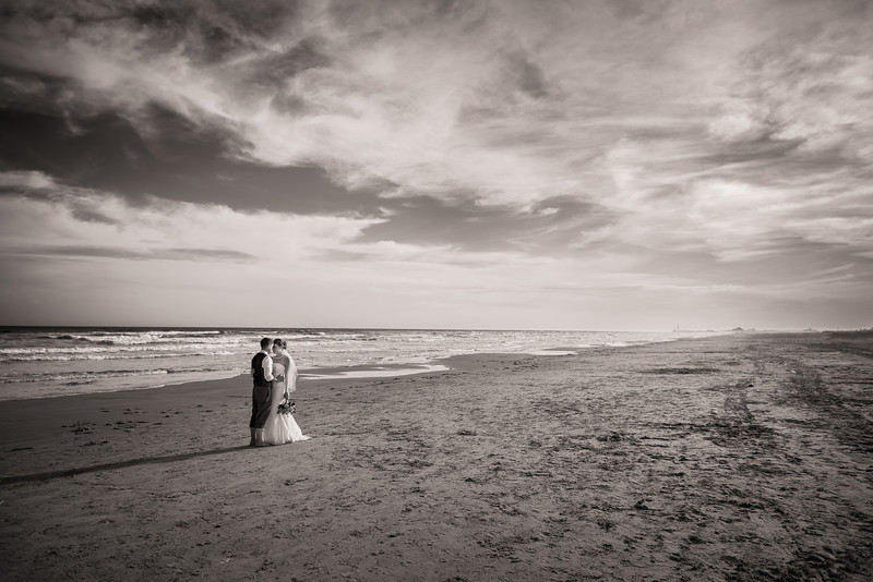"Wedding Landscape, Galveston TX  Lindsay and Kevin are such an awesomely in love couple that I'm pretty sure they don't even remember I was there!  But their special day on the beach was a special day for me too.  I'm so lucky that the amazing <a href=""http://www.thesilhouettestudio.com"">Sarah Williams</a> let me assist her with this beautiful wedding.  I learned so much from her and she has so much more to teach me.  I can't wait to do it again soon.  Being a wedding photographer's assistant and second shooter is such a fun job!  You get to enjoy all of the excitement of capturing the precious moments of the day with very little of the stress, especially if you're working with a pro like Sarah.  Of course I'm naturally stressful but Sarah kept me under cool the whole day (unfortunately she couldn't prevent the sunburn though!).  There were times when I was running around carrying camera bags and keeping track of heels and sandals, and I most definitely sweated through my shirt several times, but it was so exciting that it didn't seem like work at all and I was happy to do whatever I could to help.  For more beautiful photos from this wedding check out Sarah's awesome <a href=""http://www.thesilhouettestudioblog.com/2013/03/galveston-beach-wedding-photographer.html"">blog post</a>!  Critiques are always welcome.  Daily photo: April 1, 2013, taken March 16, 2013"