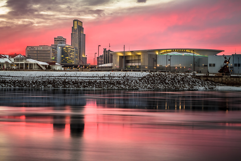 Omaha in Pink, Omaha NE<br /> <br /> Dad and I went over to the Iowa side of the Missouri River yesterday to shoot some sunset skyline photos of our favorite town.  It was nice and warm in the upper 30s.  It was really cool to see all of the ice floating by.<br /> <br /> This is a single 2.5 second exposure and I used a circular polarizer to bring out more reflection in the water.  <br /> <br /> Thanks for all of your comments while I've been away.  I hope everyone has been having a nice start to 2013!  I started my 2013 on a five night ski trip in Colorado that was amazing!  This is my first post in 2013.<br /> <br /> Critiques are always welcome.  <br /> <br /> Daily photo: January 9, 2013, taken January 8, 2013