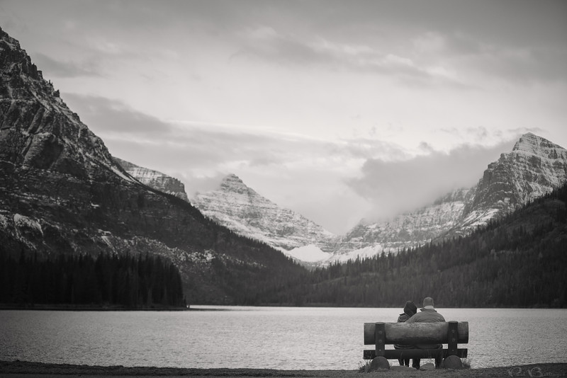 "Two Medicine Engagement, Glacier National Park MT<br /> <br /> Kristen and Jake taking in one of the most breathtaking views in the country at Two Medicine Lake in East Glacier.  We were completely blown away by the beauty of Glacier and the surrounding areas.  Kristen and Jake are the magic couple.  When they wanted snow, it snowed.  When they wanted soft light, it was cloudy.  And when they wanted inside of Glacier, the government reopened just in the nick of time.  I'm sure their mountain wedding in Red Lodge MT will be blessed as well.<br /> <br /> I have been to Glacier many times, but it had been about 8 years since I've been and I was a little worried I had overhyped it in my head.  But it completely lived up to expectations.  I haven't been everywhere in the US yet, but Glacier is still my all time favorite.  I can't wait to go back soon! <br /> <br /> Montana wedding photography by Billings Montana wedding photographer Paul Bellinger.  An artistic vision for dramatic fine art photography as unique as your love story.  How do you dream of being photographed?  Contact Billings Montana wedding photographer Paul Bellinger for any wedding destination.   <a href=""http://www.paulbellinger.com"">http://www.paulbellinger.com</a><br /> <br /> Daily photo: Oct 21, 2013, taken Oct 17, 2013"