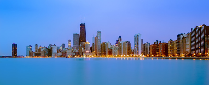 "Chicago Skyline, Chicago IL  I happened to be up for a sunrise and figured I try my luck shooting the sunrise on Lake Michigan.  The sunrise was way too cloudy, but it made for some nice blue hour light over the city.  So I changed my composition and took a few skyline photos.  I think I would really enjoy shooting cityscapes in a big city like Chicago if I ever live in one.    This is a single 30 second exposure processed in Photoshop CS6 and Lightroom 4.  Urgent!  I'm in second place! I've entered my first photo contest at the Texas Forest Trail Region Facebook page.  One of the awards is the fan favorite voting contest, which comes with a $100.00 award.  If you smuggers can help me win I'll donate the $100.00 to the National Parks.  If you don't mind ""liking"" the Texas Forest Trail Region facebook page, please vote for my ""Warm Grass Sunset"" photo <a href=""http://woobox.com/t58y4t/vote/for/315946"">here</a>.  You have to actually ""vote"" by clicking the vote button, you can't simply ""like"" or ""share."" You can vote each day through April 26th and after you've voted once it just gets easier the second time around!  Right now I'm behind by a few votes, so every vote counts.  So please vote!  THANKS!  Critiques are always welcome.  Daily photo: April 20, 2013, taken April 12, 2013"