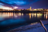 Omaha Glacier Blue Hour, Omaha NE<br /> <br /> My favorite city skyline from my last shoot in Omaha.  Dad and I set up on the East side of the Missouri river to catch this beautiful sunset and blue hour from its icy banks.  We had a blast watching big chunks of ice go twirling by as the sunset colors came and went.  <br /> <br /> This is a single two minute exposure.  I used a two-stop soft-step graduated neutral density filter to reduce the exposure of the sky and bright reflection in the top half of the frame.<br /> <br /> Critiques are always welcome.  <br /> <br /> Daily photo: January 27, 2013, taken January 8, 2013