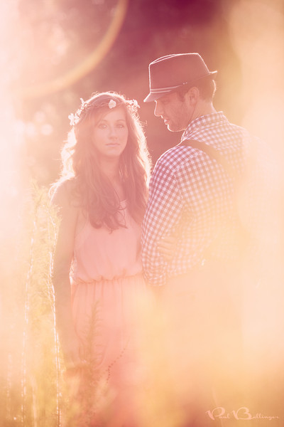 "A Romantic Dream, Huntington TX  Julie and Carsen had a vision for their fantasy engagement session.  They wanted an airy, bohemian, sun-filled, romantic dream.  This is what we gave them in return.  See more from this beautiful session on <a href=""http://www.thesilhouettestudio.com"">Sarah's</a> <a href=""http://www.thesilhouettestudioblog.com/2013/06/houston-engagement-photography-carsen.html"">blogpost</a>.  As many of you know, I'm starting a wedding photography business when we make the move to Montana later this summer.  One of the things you have to think about when starting a business is your brand, and a common exercise is to come up with a list of words that describe your brand.  For a photographer you can think of your brand as your photographic style.  So far my list of brand words includes: dramatic, romantic, artistic, fantasy, dreamlike and grand.  I think about adding the words warm and colorful too, as my photos have a tendency to get both warm and colorful (especially colorful if you're familiar with my landscapes).  As I've been culling and reprocessing my portfolio over the last few weeks I've been trying to create a consistent brand focused around these brand words.  Of course not every photo I take at a wedding looks like a dreamlike work of art.  But I hope you think the photos in my portfolio do.  Let me know what you think or if you have any other brand words that you think fit my style.  My portfolio is on the front page of my <a href=""http://www.paulbellinger.com"">Montana wedding photography website</a>.  In this photo, all of the lens flare is real and I did some minor processing in Photoshop to add contrast, color and to bring the couple out.  The bright light on the far left and right of the frame are pieces of long grass/some other vegetation in the foreground.  I love to use foreground objects to frame my subjects.  I took about five or ten shots from this grassy perspective with tons of flare, but also took several of the standard straight on, no foreground, minimal flare shots too.  The grassy flare shots may not be as technically perfect, but to me they are better at conveying the dreamy fantasy mood I'm always looking for, and the lighting is certainly more dramatic.  So that's my vision.  Getting the camera to focus while shooting into the sun with stuff in your foreground and loads of sweat in your eye and on your glasses/viewfinder is a whole different story!  Critiques are always welcome.  Daily photo: June 17, 2013, taken June 10, 2013"