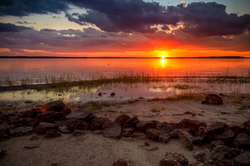 "Colorful Sunset, Lake Sam Rayburn TX<br /> <br /> A colorful sunset on our favorite beach.  Hopefully we'll be there again this weekend to have an anniversary picnic.  Today is our actual anniversary and we're celebrating with friends tonight.  Tomorrow we are giving each other our anniversary gift.  Nini is getting an hour and a half massage, hair and makeup at a local salon.  I'm getting a photoshoot with my wife!  Then we'll go out to dinner.  It should be a fun anniversary for the both of us.  Thanks for all of your anniversary wishes yesterday!<br /> <br /> CreativeLIVE is live and FREE today for the third day with wedding master photographer Marcus Bell.  Catch the FREE re-watch all night long if you miss the live version.  I actually like the re-watches better because they cut out the breaks.   <a href=""http://www.creativeLIVE.com/live"">http://www.creativeLIVE.com/live</a><br /> <br /> UPDATE:  I forgot to mention that this is a three exposure HDR.<br /> <br /> Critiques are always welcome.<br /> <br /> Daily photo: February 8, 2013, taken January 21, 2013"