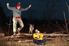 "Jump Around!, Columbia MO<br /> <br /> There was no sunset at Grindstone Nature Area yesterday, so we decided to have a little fun with a pair of speedlites.  The goal was to get a shot of Big Red leaping over the logs, but he wasn't very interested.  So I ended up jumping over the logs myself about 50 times!  I trained myself well!  In the end I didn't get the shot I envisioned, but we had a blast anyway.  For a view of me jumping over Nini see my other daily here:  <a href=""http://smu.gs/tjFwrr"">http://smu.gs/tjFwrr</a><br /> <br /> The two speedlites were placed at 45 degree angles from where Nini is sitting, shot through small umbrellas.  I was surprised to find that the flashes do a great job of freezing the action with light, so you don't need a super fast shutter speed.  This photo was shot at 1/160 of a second.  I used four cheap remote tranceivers to fire the camera and flashes from mid-air!  The tranceivers are available here:  <a href=""http://amzn.com/B004YTA15W"">http://amzn.com/B004YTA15W</a><br /> <br /> Daily post: Dec 3, 2011, taken Dec 2, 2011"