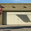 11/11/08<br /> Didn't have much time for photos today, as I flew to Tucson. In the spirit of Veteran's Day, I got this photo of the shadow of a flag on a garage door. I thought it was more interesting that a traditional flag photo.