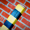 11/5/08<br /> Yay Obama!<br /> OK, that's about as political as I want to get - this gallery is about photography. Took a photo of a yellow striped post and some red bricks. I thought they made some interesting patterns. I upped the contrast quite a bit. I don't like how parts of the yellow stripes appear overexposed, but there wasn't much detail anyways.