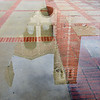 2/9/09<br /> Still more rain in LA, hooray for the water! This was taken shortly after noon when the rain had stopped, but puddles hadn't dried up yet. This is a reflection of Royce Hall. I like how I was able to get only the students' legs in the shot. I played around to get better clarity on the reflection, but I ended up backing off of many of my edits so it looked more natural. I tend to overdo the contrast...