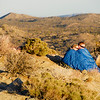 "2/14/09 Today was our first day in Joshua Tree National Park, and I tried to make a Valentine-themed photo. A wonderful place to watch the sunset is Keys View, which has amazing views of the entire Coachella Valley, San Jacinto and San Gorgonio peaks, provided the air quality isn't horrible. Well, it was pretty bad today, so I got a shot facing East, where this couple was watching the sun go down. It was freezing, hence the sleeping bag. I have no idea who they are, in case you're wondering. Don't forget, today is also Arizona statehood day!  More <a href=""http://jawsnap.smugmug.com/gallery/7404666_xQMbC"">Joshua Tree photos</a>!"
