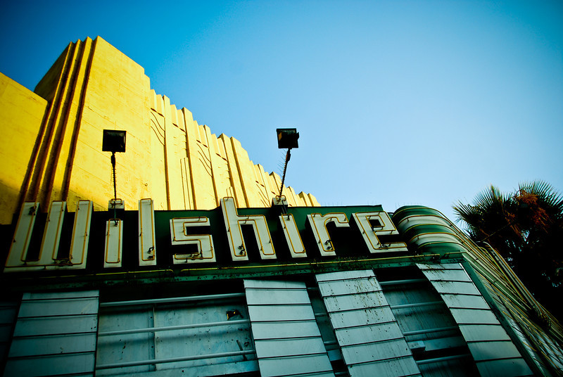 8/25/08<br /> The dilapidated Wilshire theater in Santa Monica. I had hoped to get the sun shining on the marquee, but I got there too late. After doing some processing in Lightroom, I think I actually like this better. I'd like to say that it's nice to finally have a daily using a wide angle - I've been doing mostly macros lately.