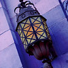 5/10/08<br /> An old fairly intricate lamp on the side of the humanities building at UCLA. I had fun photoshopping it to make it appear as if it was lit (it was not), and then messed around with some colors that I found pleasing. I know that it would be more believable if there was some glow projected on the wall, but I don't really know how to do that well, and it's too late for me to care :)