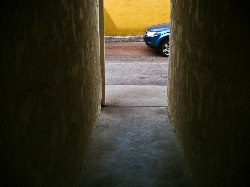Blue Car, Yellow Wall