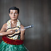 "<span id=""date"">_11/08/10_</span> <span id=""title"">Little Hawaiian</span> My wife picked up this ukelele-playing, lei-wearing, grass skirt-rocking fellow from Hilo when she visited about 10 years ago. We're going back there in a couple weeks to celebrate our two-year anniversary. We're pretty darn excited.  I haven't yet decided how I'm going to handle my daily photos, but I'm leaning towards the iPhone like I've done for some other week-long vacations. For this shot there's an off-camera flash to the left, the background is a striped placemat, and I shot at f/1.4. In Lightroom I added vignetting and clarity.  Oh, and in case you missed it, my photos from the <a href=""http://www.jawsnap.net/Misc/2010/Oceano-Dunes/14562441_pqKAF"">Oceano Dunes</a> are all up and geotagged. Still gotta write some captions, but I'll do that soon.  <a href=""http://www.jawsnap.net/Daily/year2/7157835_BfJPF#707717797_vHSeb"">[last year]</a> <em>we have yet to drink from these...</em>"