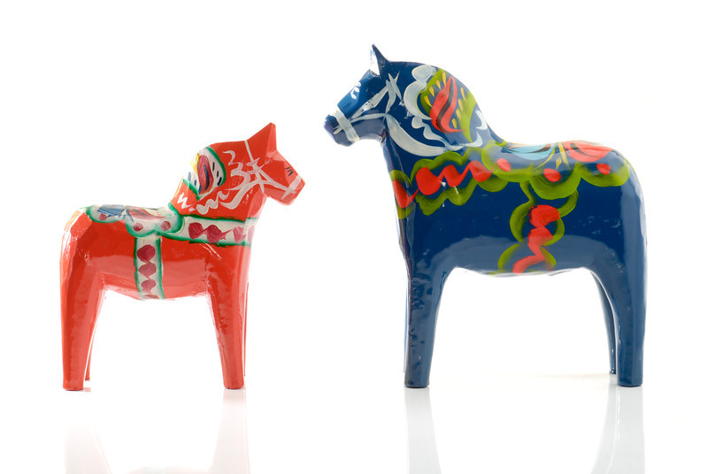 """<span id=""""date"""">_06/29/10_</span> <span id=""""title"""">Dala Horses</span> Two <a href=""""http://en.wikipedia.org/wiki/Dalecarlian_horse"""">dala horses</a> that we got from my parents when they visited over the weekend. They were originally at my grandfather's house and I believe he purchased them in Sweden when he visited some relatives there. They were made by Nils Olsson. See the <a href=""""http://www.jawsnap.net/Utility/Setups/8246339_SpVpq#918378697_kd2V7"""">setup photo</a> to see the amazing cutting-edge technology used to create this digital photograph.  <a href=""""http://www.jawsnap.net/Daily/year2/7157835_BfJPF#577831868_JMUYw"""">[last year]</a>"""