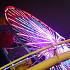 """<span id=""""date"""">_10/21/10_</span> <span id=""""title"""">Wheel at Night</span> I went for a walk tonight, and made it all the way to the Santa Monica Pier where this Ferris wheel is (along with a roller coaster). Armed with a sense of pride after walking the amazing distance of nearly three miles, I went to McDonald's to reward myself with a hot fudge sundae. And then my wife picked me up so I didn't have to walk home. Hey, that's 3/7 deadly sins! This shot benefited nicely from LR3's improved noise reduction tools. Incredible difference from LR2.  <a href=""""http://www.jawsnap.net/Daily/year2/7157835_BfJPF#688723583_5jWTA"""">[last year]</a>"""