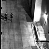 """<span id=""""date"""">__01/29/11__</span> <span id=""""title"""">Walking in Black</span> These two women were photographed while walking down an alley in Santa Monica. My position was on level 8 of a parking garage. We had just watched True Grit. I liked it.  You may have noticed that this photo is a bit gritty. Truly, it's because of the ISO noise.  <a href=""""http://www.jawsnap.net/Daily/year2/7157835_BfJPF#776411998_XMTot"""">[last year]</a>"""