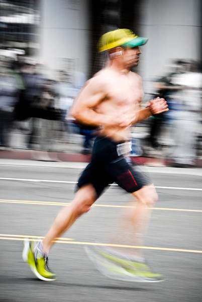 """<span id=""""date"""">_03/21/10_</span> <span id=""""title"""">Runner in Motion</span> Today I checked out the <a href=""""http://www.lamarathon.com/"""">LA Marathon</a> - it has a new route that finishes next to the Santa Monica pier after passing dozens of LA landmarks. I got this shot at mile 26. I experimented with a lot of shots, such as focusing on shoes, faces, panning with the subject, and purposeful motion blur. I like this shot because I find the different blurs very interesting (from panning the camera and his body moving). I desaturated most of the background to make the runner stand out, and added a bit of contrast and clarity. I have some more decent shots, I'll try and post them later.  <a href=""""http://www.jawsnap.net/gallery/7157835_BfJPF#496210936_hKC8g"""">[last year]</a>"""