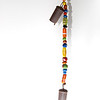 """<span id=""""date"""">__01/20/11__</span> <span id=""""title"""">Hippy Wind Chime</span> This belonged to my parents-in-law, who aren't exactly hippies, but to me, it looks like something that you'd find hanging in a VW Bus with shag carpet. Just sayin'. I used the same setup as I've been using for my water droplet photos - the chime was hanging from a curtain rod resting across a white presentation foam board. I had trouble getting the lighting right with only one flash, so I decided to make the shadow a part of the scene. My off-camera flash is just underneath and in front of the bottom bell, pointing mostly at the back of the presentation board. I played around and adjusted the level so that the shadow cast by my on-camera flash would fade into white about halfway down.  <a href=""""http://www.jawsnap.net/Daily/year2/7157835_BfJPF#769679076_K5rWf"""">[last year]</a>"""