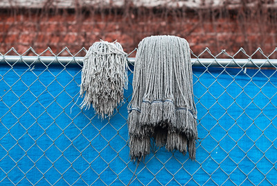 __01/30/11__ Out to Dry I went for a quick photo walk this evening before the sun set and liked this shot of two very different mops outside a gym. Have a great week!  [last year]
