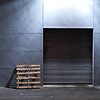 "<span id=""date"">_09/17/10_</span> <span id=""title"">Pallet and Door</span> Tonight I went for a long walk around the neighborhood at night. Armed with the 50mm f/1.4, I mostly took photos of lights because, well, it was dark. This was my favorite for it's composition and simplicity. I knew it was a decent shot when I took it, so I spent the time to get it right at 1/15 seconds so I didn't have to max out the ISO. The ISO 1600 shots were just too grainy, although slightly sharper than this one.  <a href=""http://www.jawsnap.net/Daily/year2/7157835_BfJPF#652848886_axiiR"">[last year]</a>"