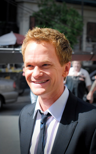 """<span id=""""date"""">_03/26/10_</span> <span id=""""title"""">Neil</span> Neil Patrick Harris, that is. I met him, as well as the rest of the cast of How I Met Your Mother! Due to some super-fancy connections my wife has, we got to hang out on the set today as they shot parts of the season finale at Fox studios in Century City. Spoiler alert: they all die. Well, OK, that's not what happens but you'll just have to wait until it airs. I didn't get any amazing shots, but this was my favorite of NPH. They were all nice, but he and Alyson Hannigan were <em>super</em> friendly. I touched up the photo by cropping in close, adding some vignetting and desaturating the background a bit. Being at the studio during a shoot was pretty cool. It was neat to see the actors, the equipment and the complex process that results in just a few seconds of screen time. I was really surprised at how many different people were involved.  <a href=""""http://www.jawsnap.net/gallery/7157835_BfJPF#499703293_Ynzvo"""">[last year]</a>"""