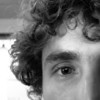 """<span id=""""date"""">__01/05/11__</span> <span id=""""title"""">Alan</span> This curly-haired fellow is Alan. We work together and were at a farewell party for one of our bosses. I had hoped to get her as the photo of the day, but too many people had said too many nice things about her and she was in no mood to be photographed. As you can see, it worked out. I haven't done a portrait for a daily photo since <a href=""""http://www.jawsnap.net/Daily/year3/11272102_ACXDJ#1072478145_sXVno"""">Halloween</a>, unless you count <a href=""""http://www.jawsnap.net/Daily/year3/11272102_ACXDJ#1096457758_2eDsW"""">this mashup</a>.  In other news, check out my newest post - <a href=""""http://blog.jawsnap.net/2011/01/8-crazy-days-in-hawaii/"""">8 Crazy Days in Hawaii</a>. We did so much on the trip that it's taken forever to write, but I'm pretty happy with it.  <a href=""""http://www.jawsnap.net/Daily/year2/7157835_BfJPF#758360693_szCYF"""">[last year]</a> <em>also curly...</em>"""